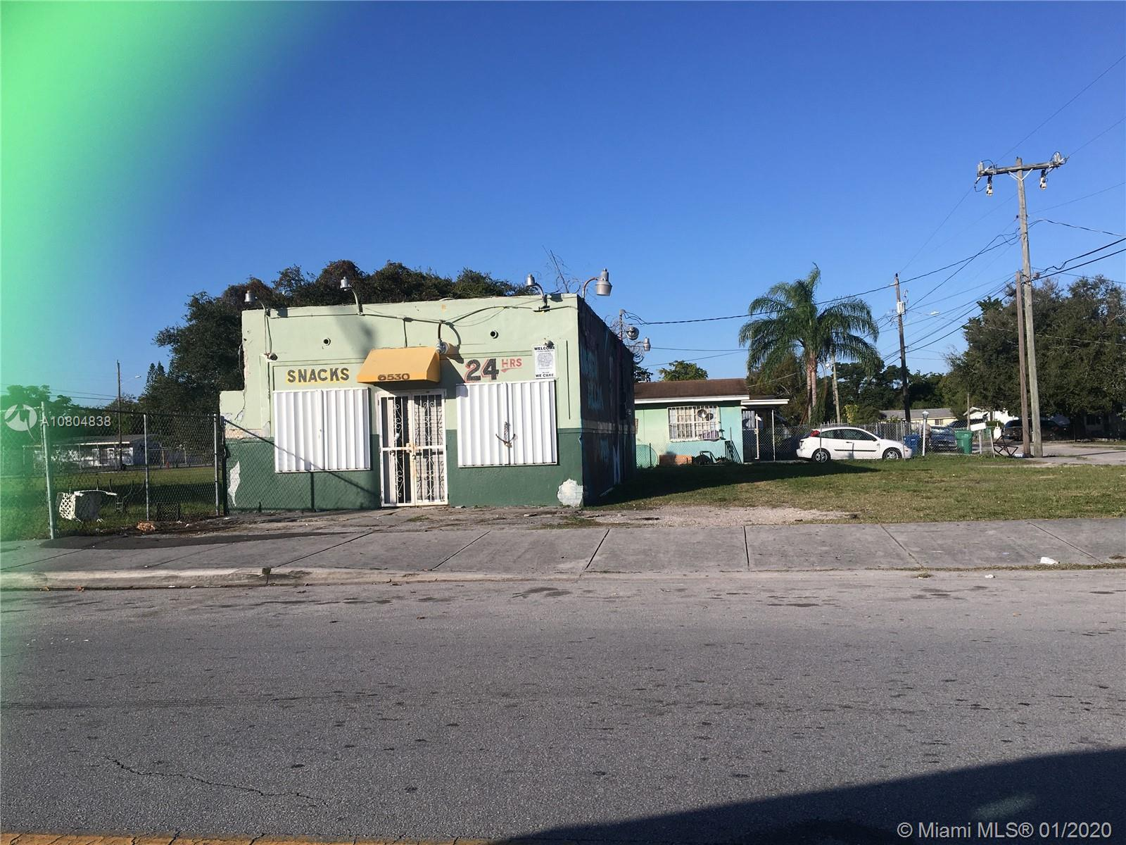 6874 NW 18th Ave Luxury Real Estate