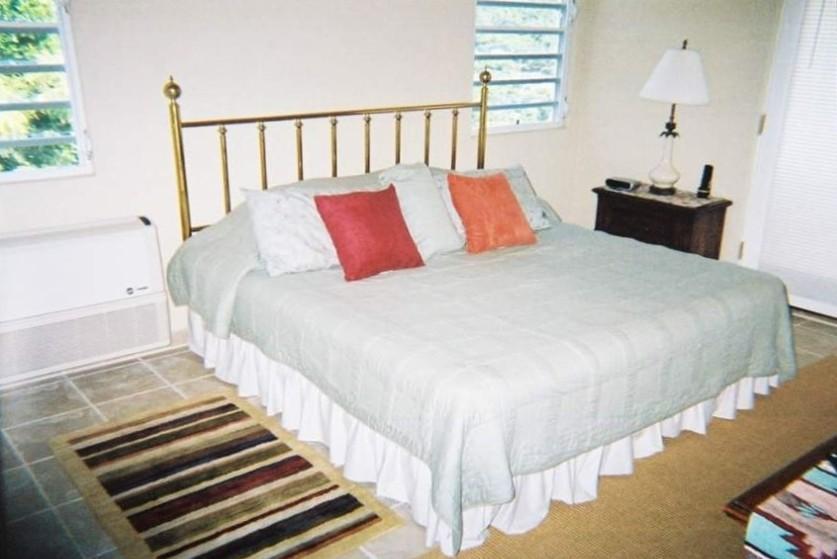 Master bedroom has brass bed!