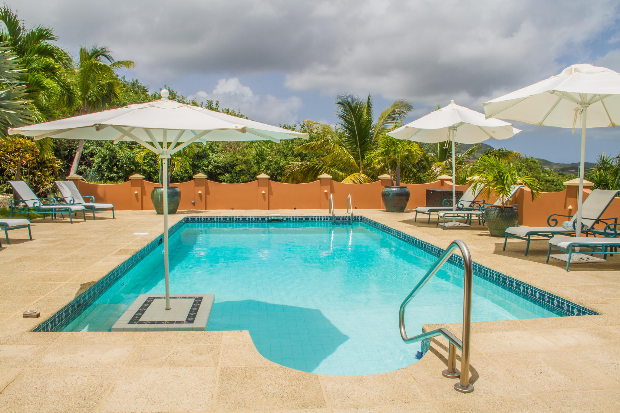 Resort style pool with swim up table