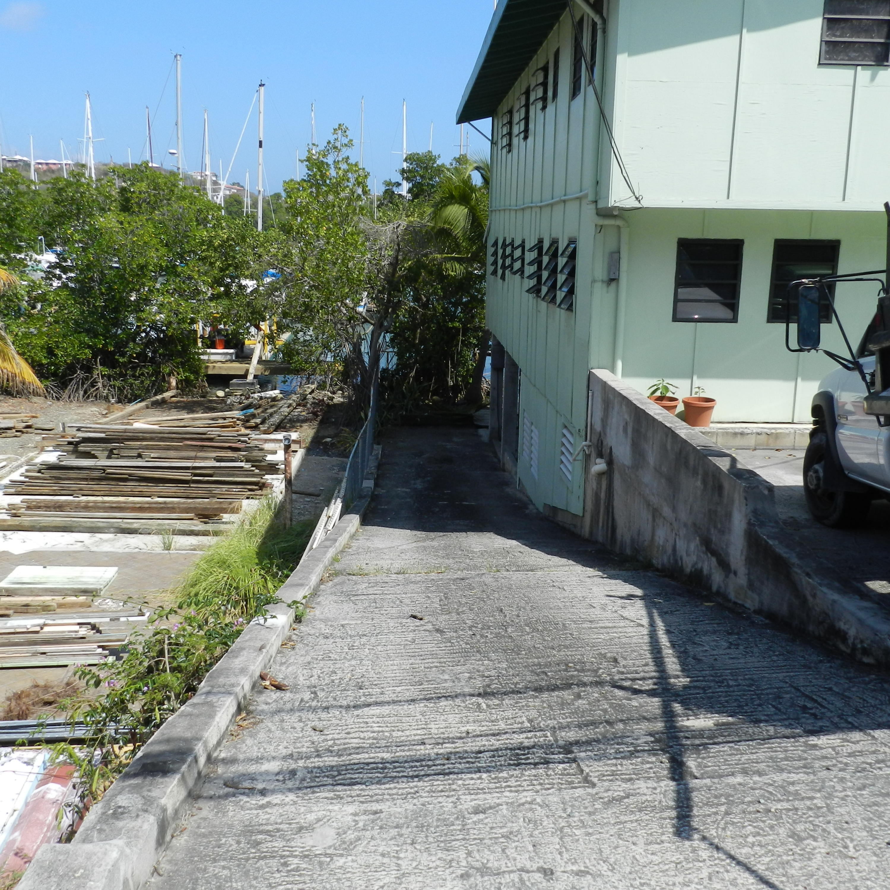 Driveway to dock and lower apartment
