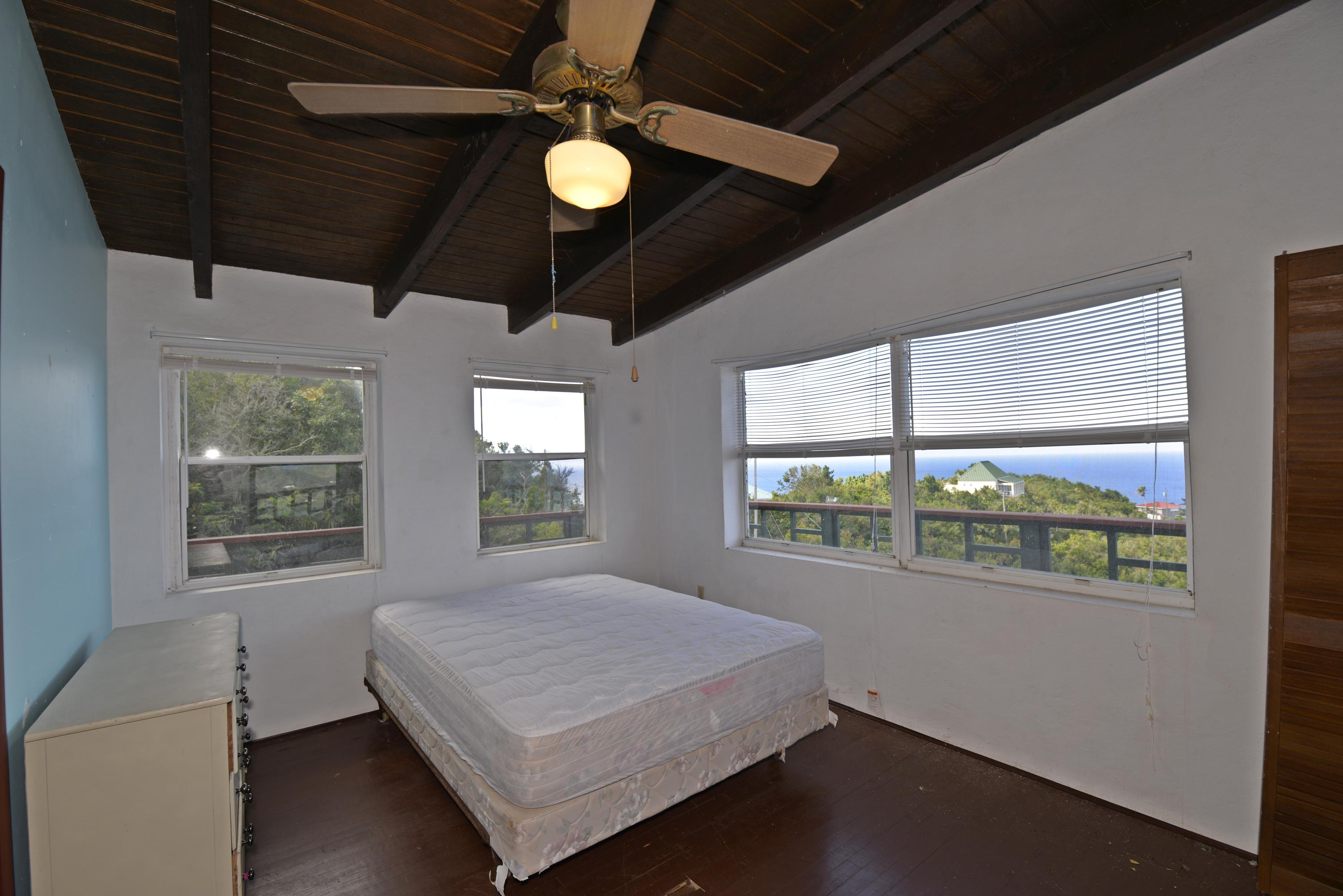 Upper level bedroom 2 with sea views