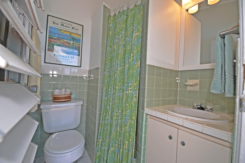 Guest bath en-suite opens to pool