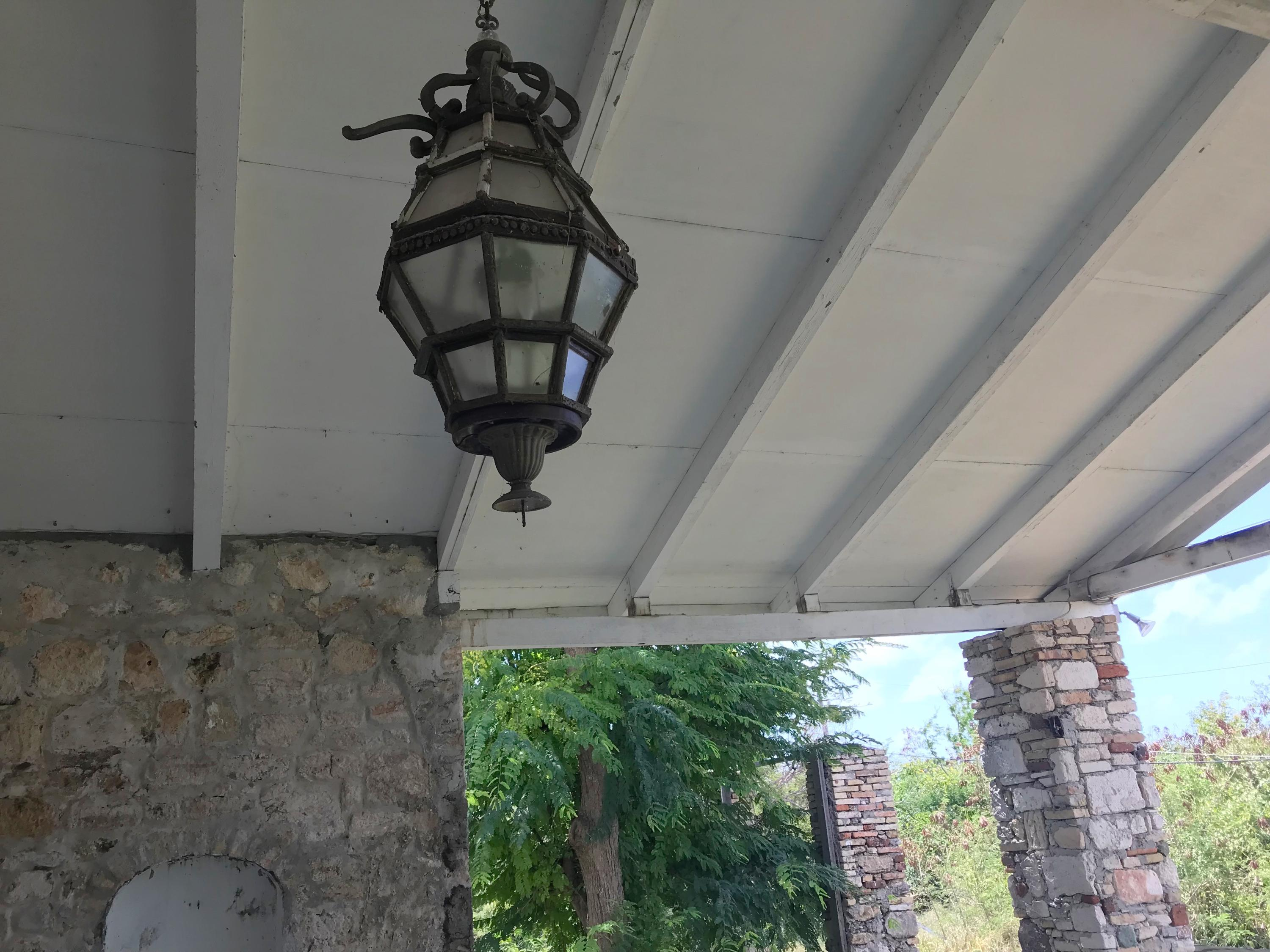 old light fixture on back porch