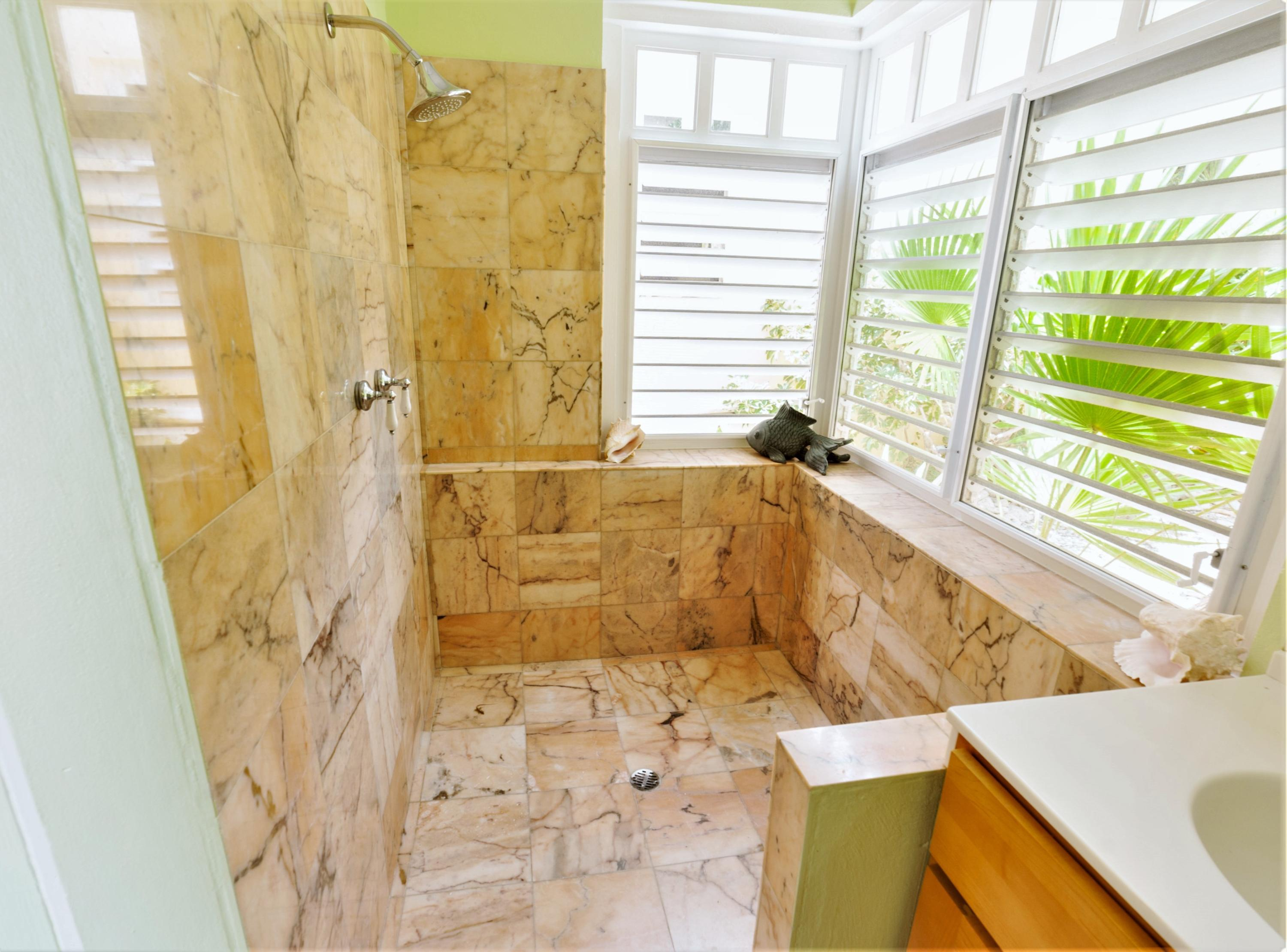 Spacious Marble Tiled Guests Bath