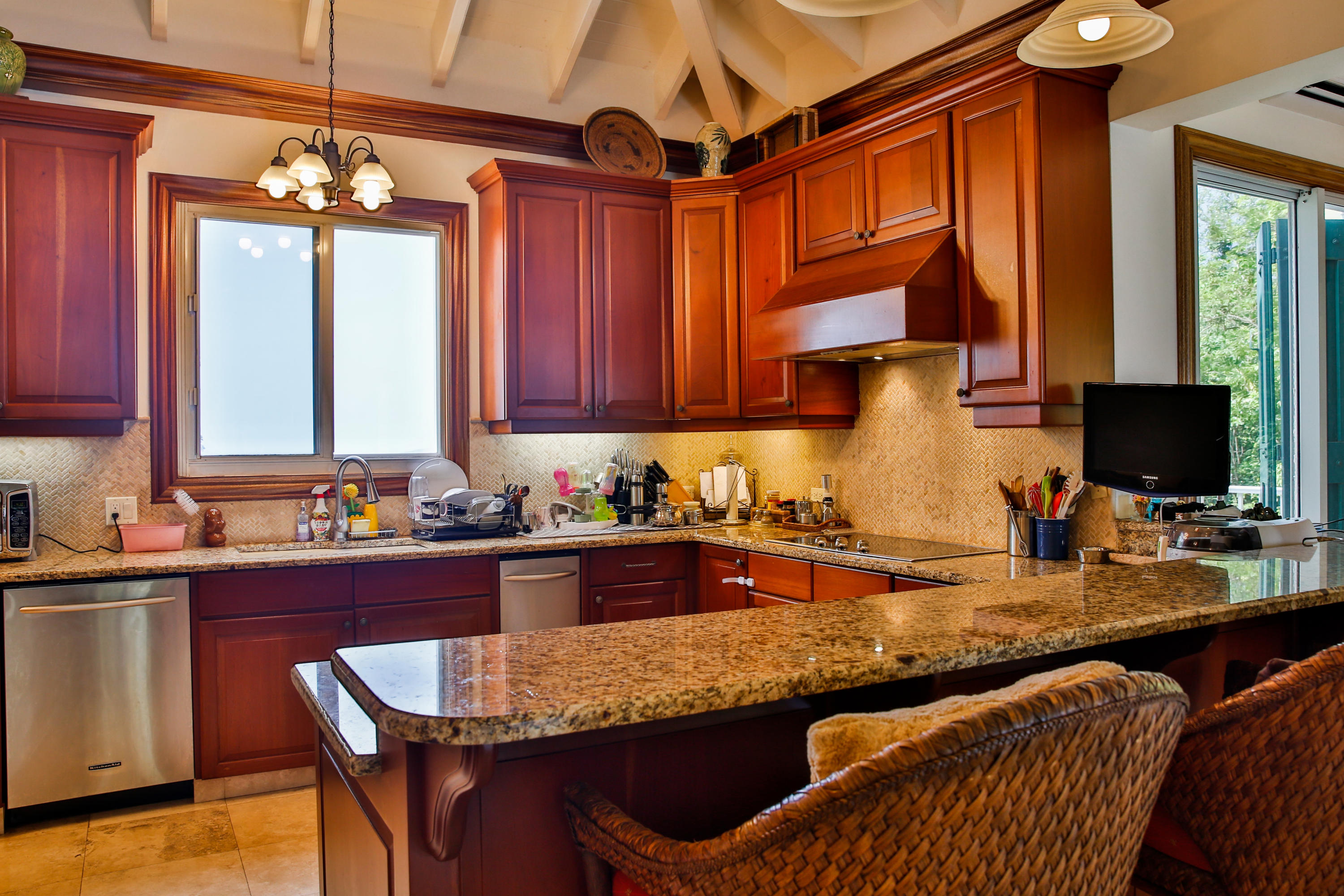 Wooden Cabinets in well equipped kitchen