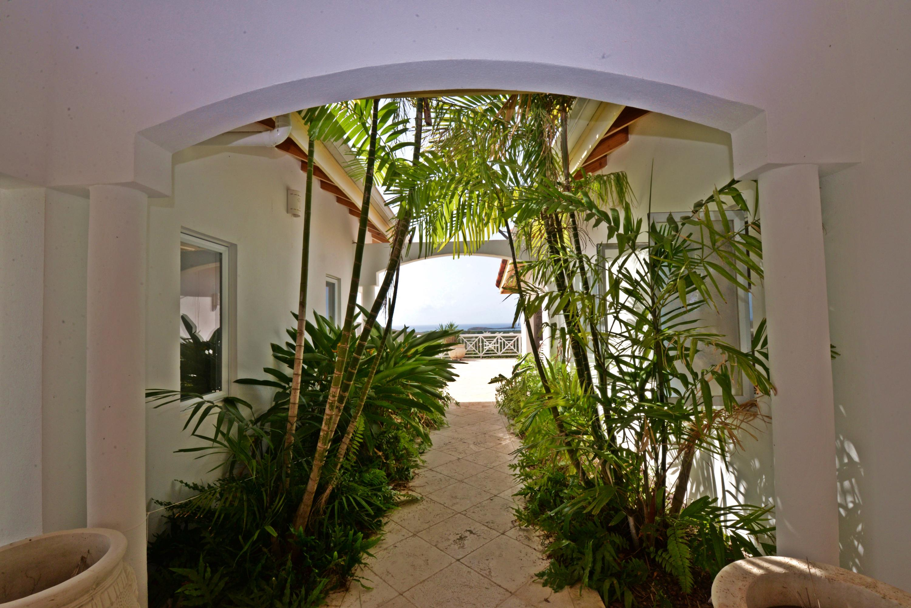 Beautiful archway leads to pool & views
