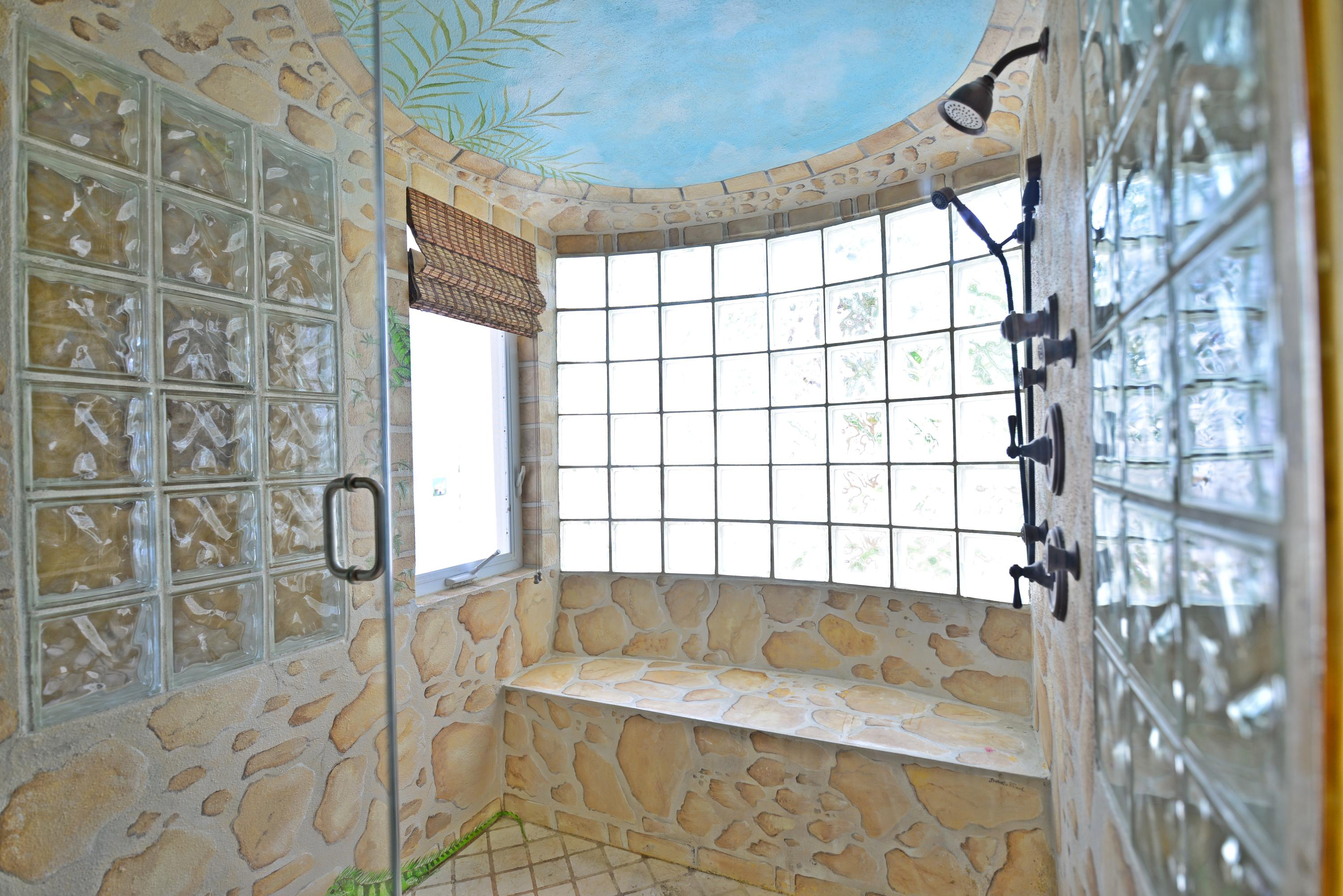 Master shower with sugar mill mural