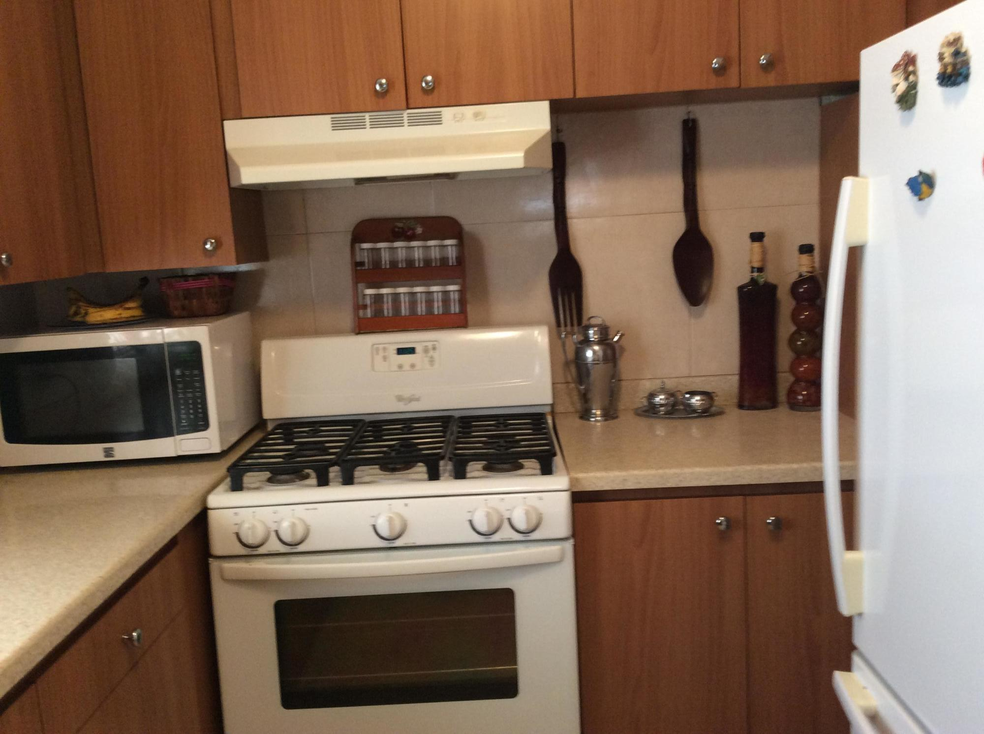 Kitchen with microwave oven