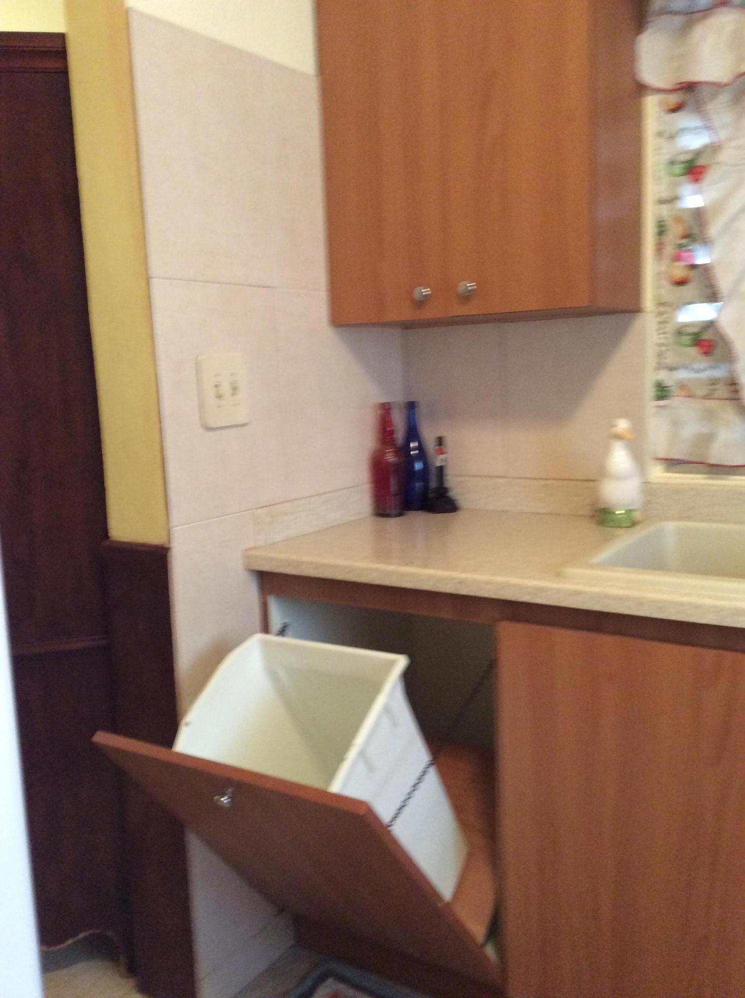 Trash recepticle in kitchen