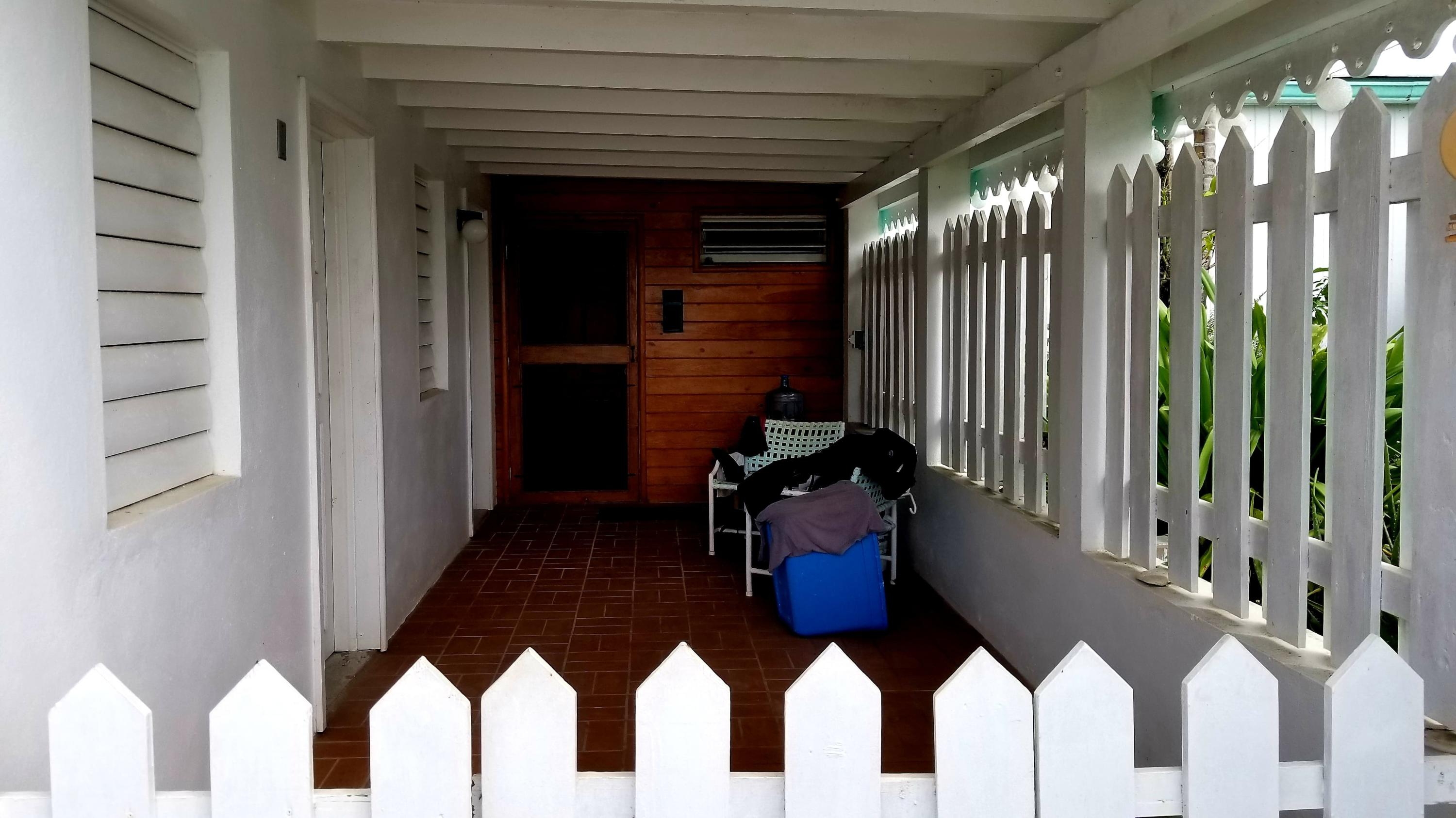 Covered patio leading to front door
