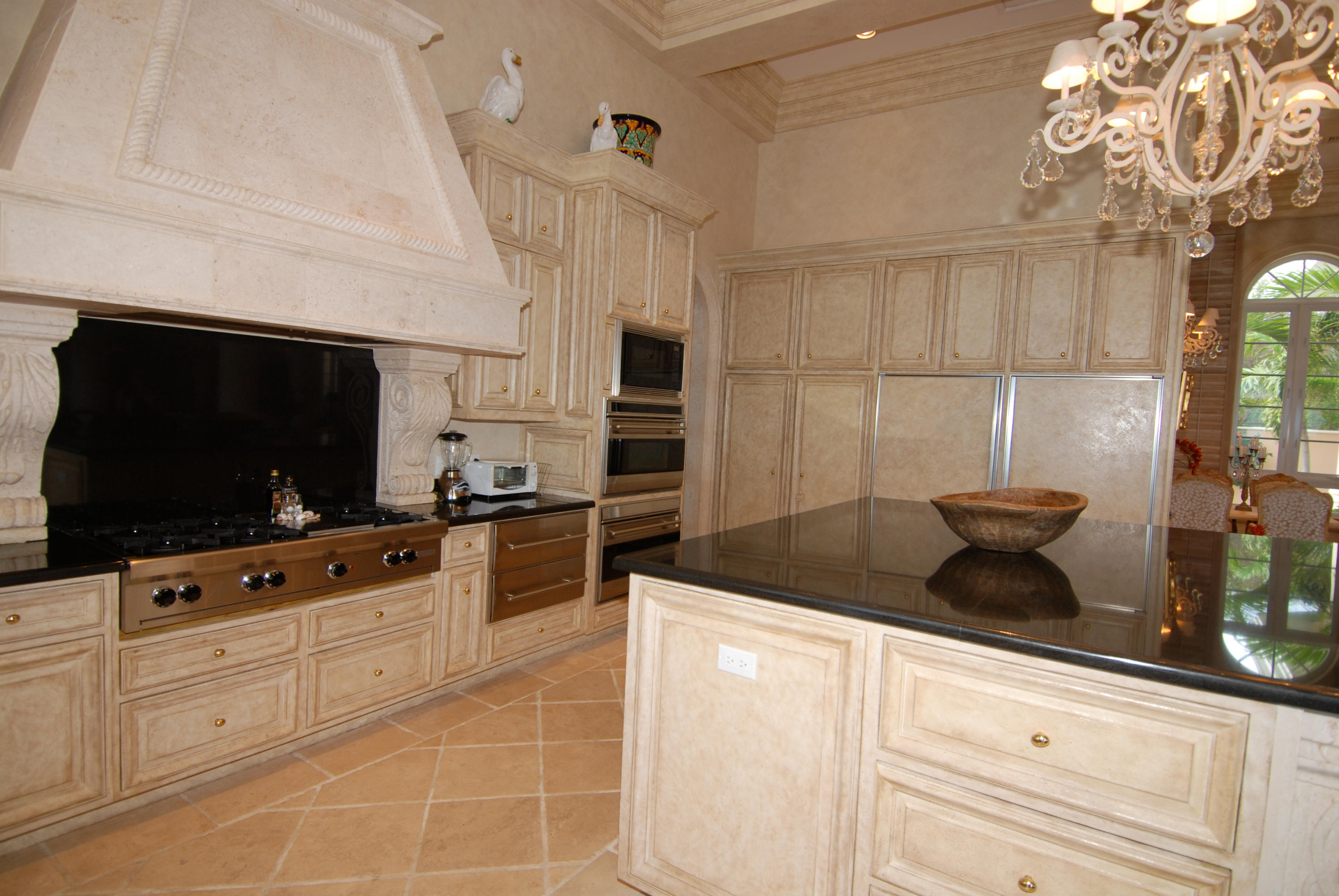 Gourmet kitchen with coral stone hood