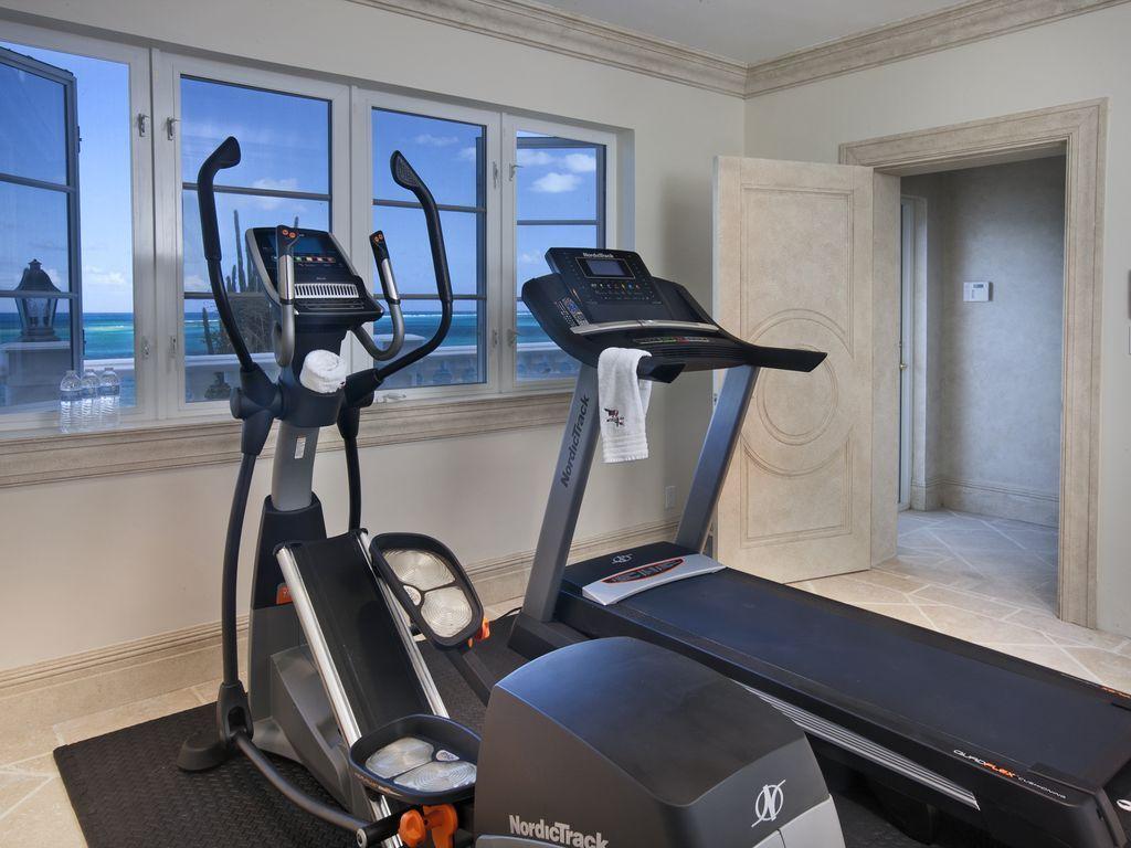 Gym with Caribbean Sea views