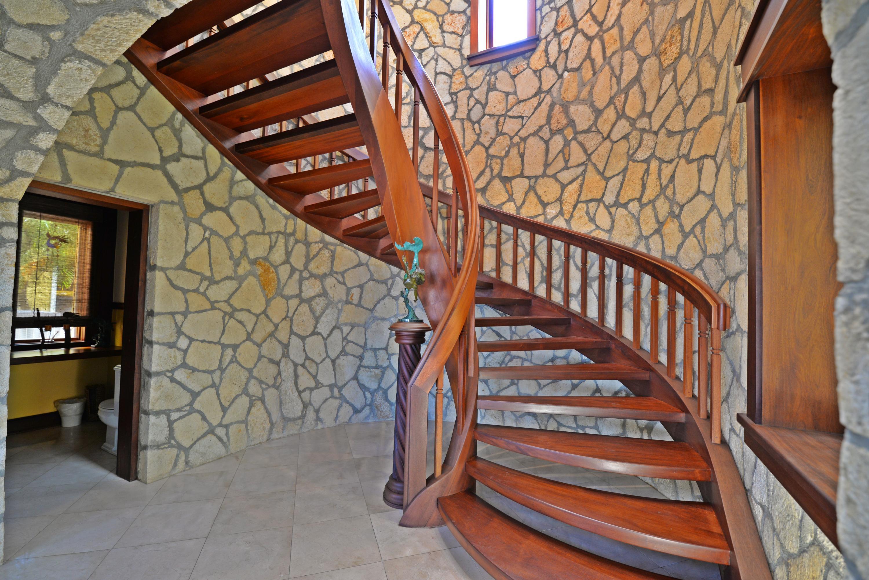 Half bath under spiral staircase