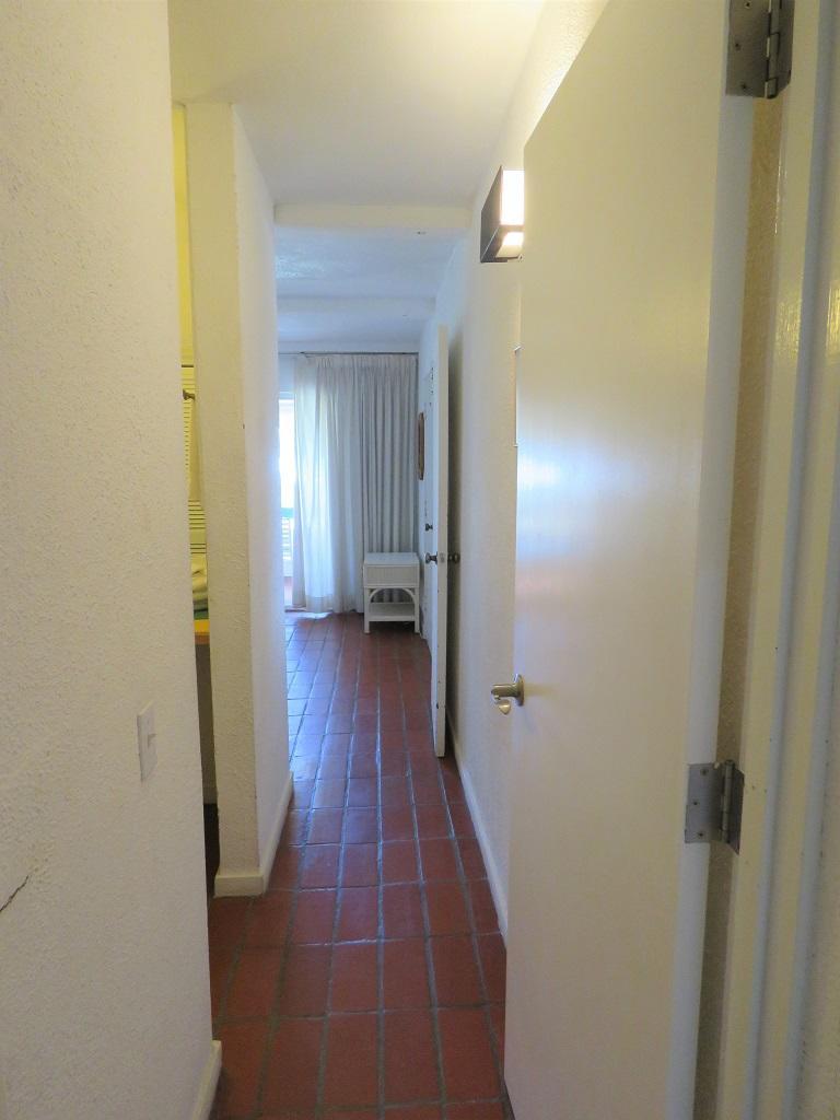 Hallway between bedrooms downstairs